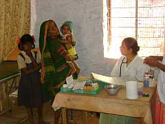 Bhoini - Doctor talking to a tribal woman.